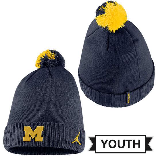 5ee3a0d1ef4879 Jordan University of Michigan Football Youth Navy Sideline Cuffed Pom Knit  Hat. Product Thumbnail Product Thumbnail Product Thumbnail
