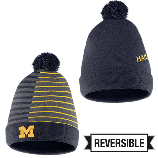 cf2f1aba88de3f ... new arrivals nike university of michigan reversible striped cuffed knit  hat with removable pom ff445 043fe